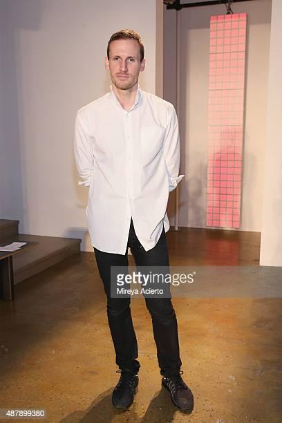 Fashion designer Dion Lee poses backstage at the Dion Lee fashion show during Spring 2016 MADE Fashion Week at Milk Studios on September 12 2015 in...