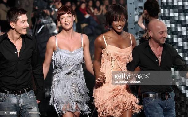 Fashion designer Domenico Dolce, model Linda Evangelista, model Naomi Campbell, and designer Stefano Gabbana walk on the runway after the Dolce &...