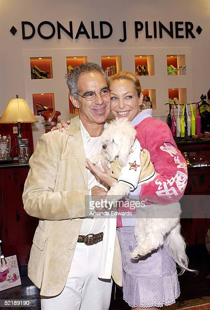 Fashion designer Donald J Pliner his wife Lisa and their dog Baby Doll attend a preGrammy benefit event on February 12 2005 at the Donald J Pliner...