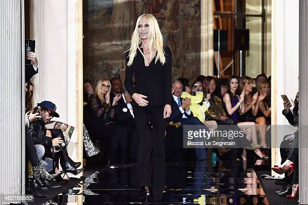 Fashion designer Donatella Versace acknowledges the applause of the audience after the Versace show as part of Paris Fashion Week Haute Couture...