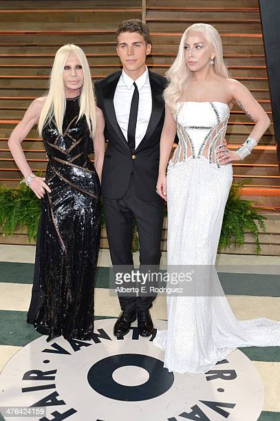 Fashion designer Donatella Versace actor Nolan Gerard Funk and recording artist Lady GaGa attends the 2014 Vanity Fair Oscar Party hosted by Graydon...