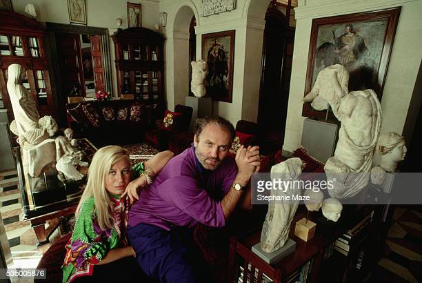 Fashion designer Donatella Versace and her brother Gianni sit among the artworks they have collected in their home in Milan.