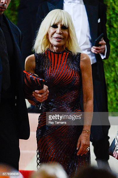 Fashion designer Donatella Versace leaves the Manus x Machina Fashion In An Age Of Technology Costume Institute Gala at the Metropolitan Museum Of...