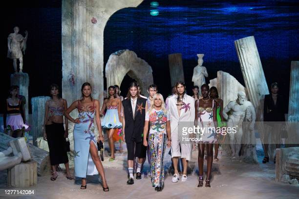 Fashion designer Donatella Versace walks the runway at the end of Versace fashion show during the Milan Women's Fashion Week on September 25, 2020 in...