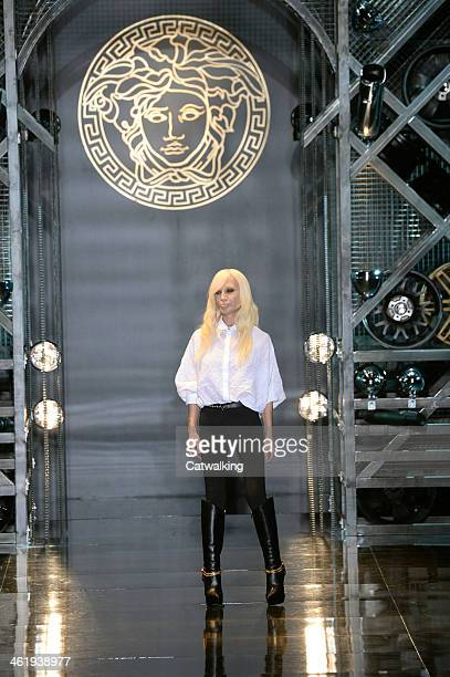 Fashion designer Donatella Versace walks the runway at the Versace Autumn Winter 2014 fashion show during Milan Menswear Fashion Week on January 11...