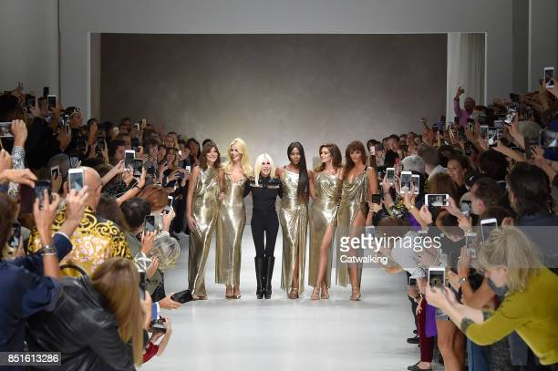 Fashion designer Donatella Versace with Supermodels LR Carla Bruni Claudia Schiffer Naomi Campbell Cindy Crawford Helena Christensen walk the runway...