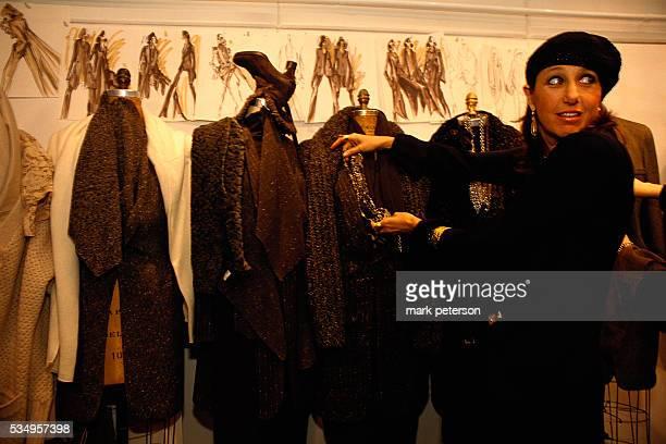 Fashion Designer Donna Karan Adjusting Clothing