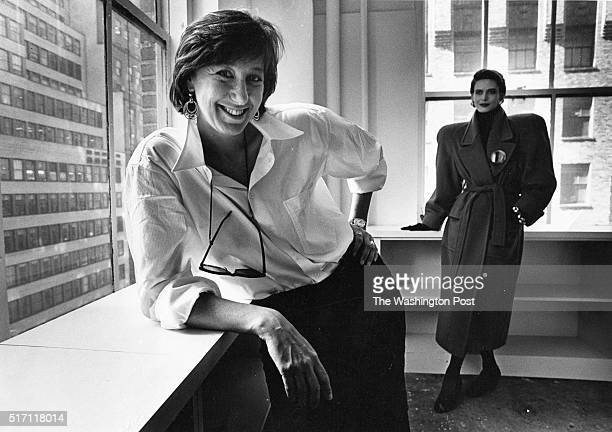 Fashion Designer Donna Karan is photographed in front of a mannequin wearing an outfit from her clothing line on May 31 1985