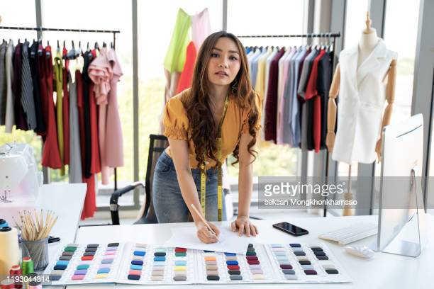 fashion designer drawing a concept - fashion showroom stock pictures, royalty-free photos & images