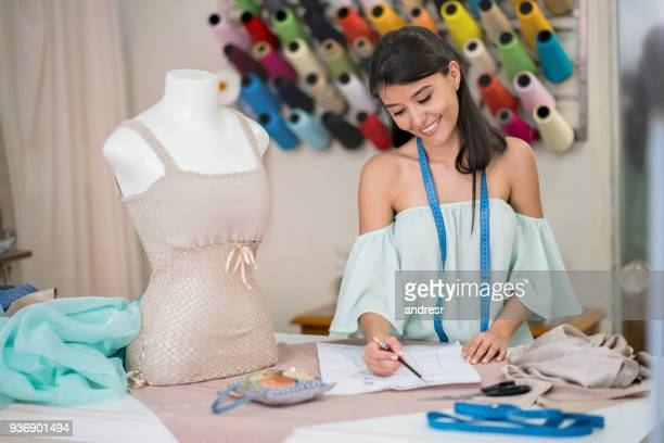 Fashion designer drawing a dress pattern at an atelier