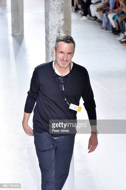 Fashion designer Dries van Noten acknowledges the audience on the runway during the Dries Van Noten Menswear Spring/Summer 2019 show as part of Paris...