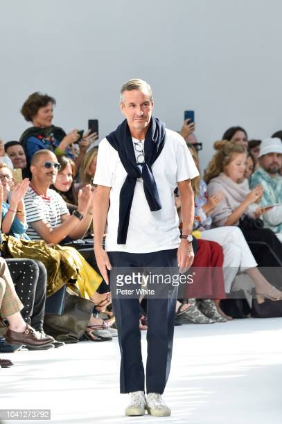 Fashion designer Dries van Noten walks the runway after the Dries Van Noten show as part of the Paris Fashion Week Womenswear Spring/Summer 2019 on...