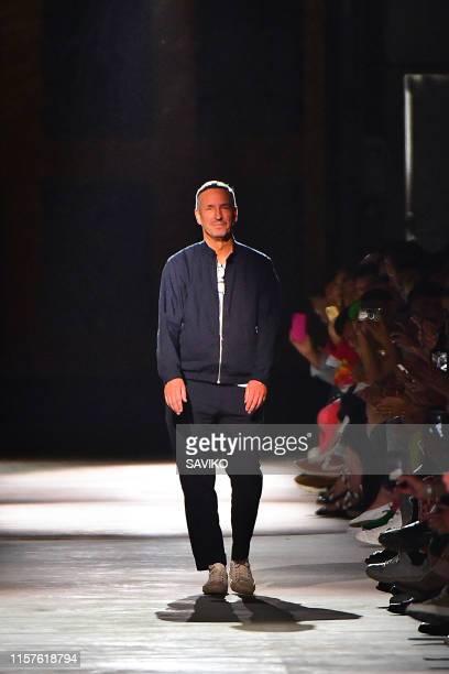 Fashion designer Dries Van Noten walks the runway at the Dries Van Noten fashion show during Paris Men's Fashion Week Spring/Summer 2020 on June 20,...