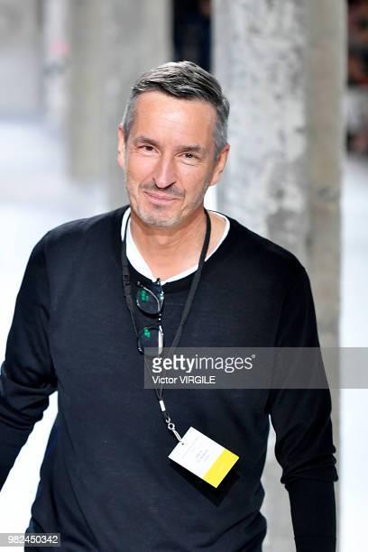 Fashion designer Dries van Noten walks the runway during the Dries Van Noten Menswear Spring/Summer 2019 fashion show as part of Paris Fashion Week...