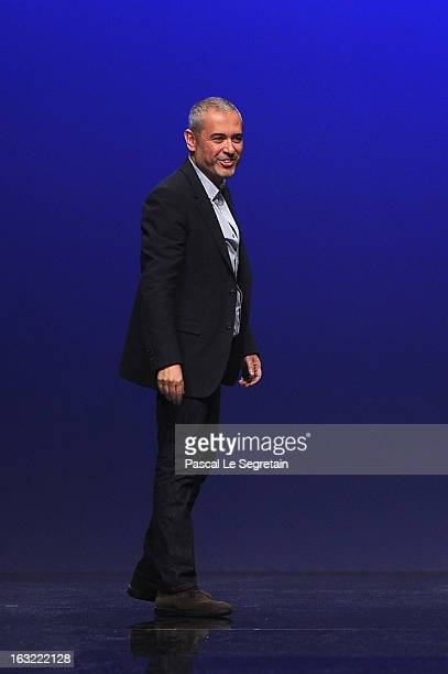 Fashion designer Elie Saab acknowledges applause following Elie Saab Fall/Winter 2013 Ready-to-Wear show as part of Paris Fashion Week on March 6,...