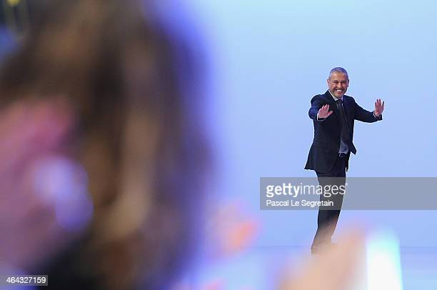 Fashion designer Elie Saab acknowledges the applause of the audience after his show as part of Paris Fashion Week Haute Couture Spring/Summer 2014 on...