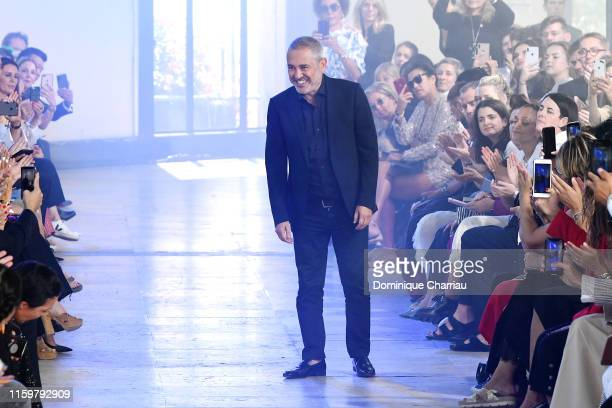 Fashion designer Elie Saab acknowledges the audience during the Elie Saab Haute Couture Fall/Winter 2019 2020 show as part of Paris Fashion Week on...