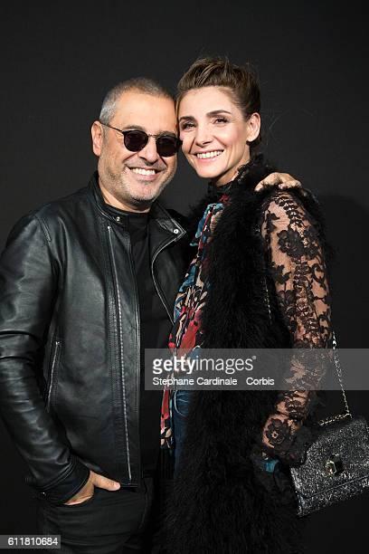 Fashion designer Elie Saab and Clotilde Courau pose backstage prior the Elie Saab show as part of the Paris Fashion Week Womenswear Spring/Summer...