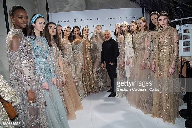 Fashion designer Elie Saab and models pose Backstage after the Elie Saab Spring Summer 2017 show as part of Paris Fashion Week on January 25 2017 in...
