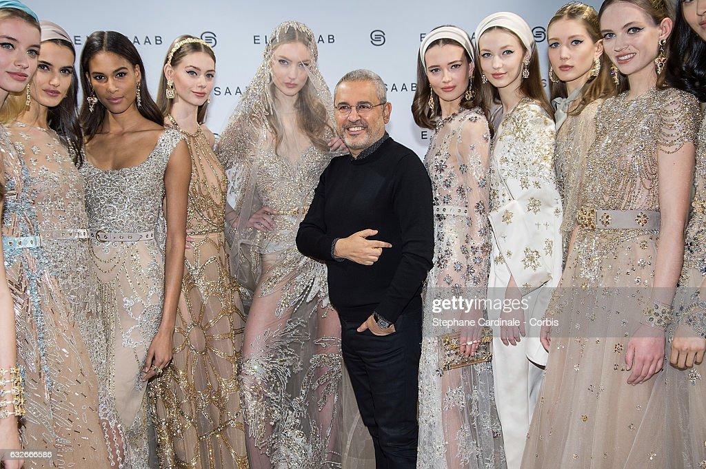 Fashion designer Elie Saab and models pose Backstage after ...