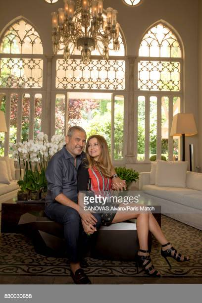 Fashion designer Elie Saab is photographed at home with his wife Claudine for Paris Match on June 24 2017 in Beirut Lebanon