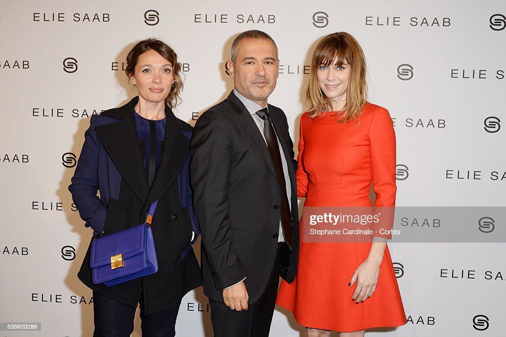 Fashion designer Elie Saab poses with Anne Marivin (L) and Marie-Josee Croze after his show as part of Paris Fashion Week Haute Couture Spring/Summer 2014 , at Theatre National de Chaillot, in Paris.