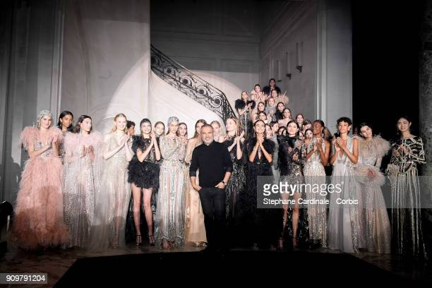 Fashion designer Elie Saab poses with models after the Elie Saab Spring Summer 2018 show as part of Paris Fashion Week on January 24 2018 in Paris...