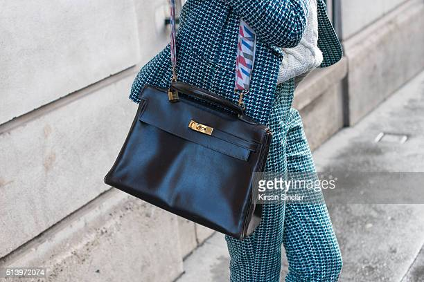 Fashion designer Elisa Chalman wears a Promod collaboration suit Sandro sweater and Hermes bag on day 2 during Paris Fashion Week Autumn/Winter...