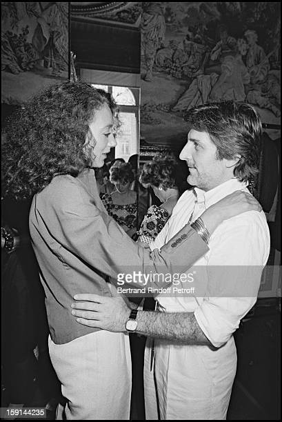 Fashion designer Emanuel Ungaro and Marisa Berenson attend a fashion in Paris in 1981