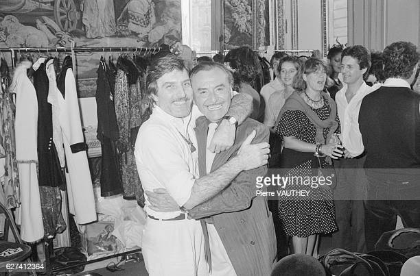 Fashion designer Emanuel Ungaro hugs his hairstylist Alexandre backstage during a 19811982 FallWinter haute couture fashion show for Ungaro's French...