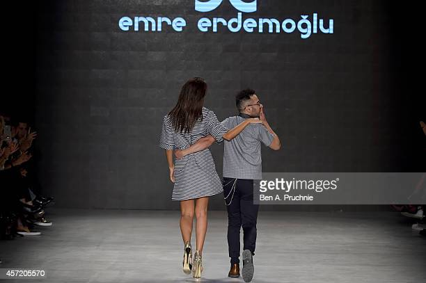 Fashion designer Emre Erdemoglu acknowledges the applause of the audience after the Emre Erdemoglu show during Mercedes Benz Fashion Week Istanbul...