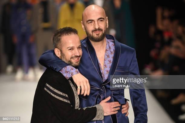 Fashion designer Emre Erdemoglu and singer Soner Sarikabadayi walk the runway at the Emre Erdemoglu show during Mercedes Benz Fashion Week Istanbul...