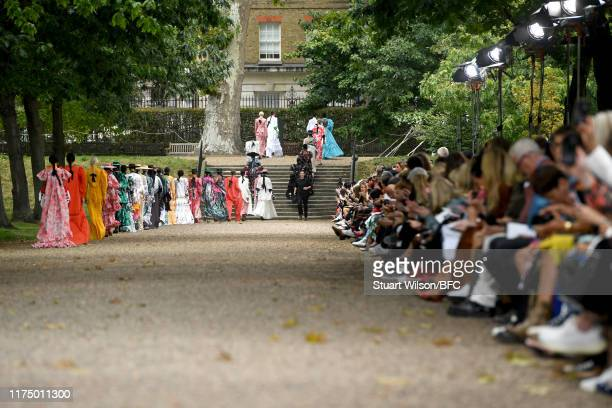 Fashion designer Erdem Moralioglu on the runway at the finale of his show during London Fashion Week September 2019 at Grays Inn Gardens on September...