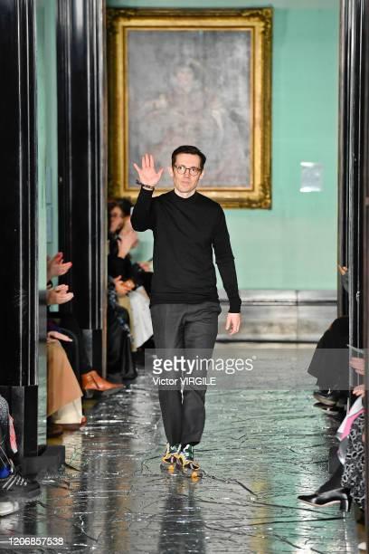Fashion designer Erdem Moralioglu walks the runway at the Erdem Ready to Wear Fall/Winter 20202021 fashion show during London Fashion Week on...