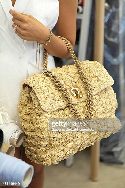 107466008 Fashion designer Ermanno Scervino workshop is photographed for Madame Figaro on September 5 2013 in Florence Italy Knitted rafia bag from...