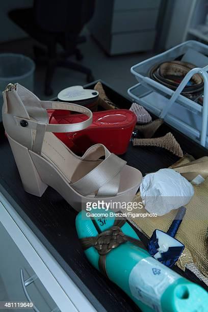 Fashion designer Ermanno Scervino workshop is photographed for Madame Figaro on September 5, 2013 in Florence, Italy. Designer's shoes. CREDIT MUST...
