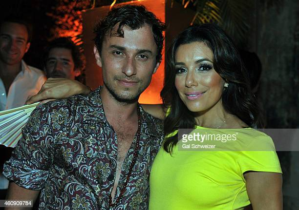 Fashion designer Esteban Cortazar and actress Eva Longoria pose for a photo during the Pre New Year´s Affair in celebration of the Opening of W...