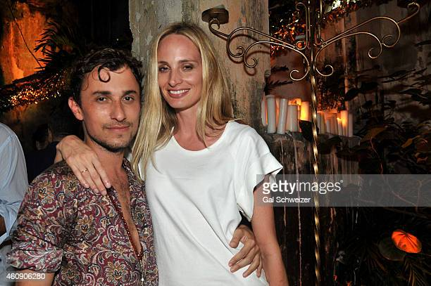 Fashion designer Esteban Cortazar and Lauren Santo Domingo pose for a photo during the Pre New Year´s Affair in celebration of the Opening of W...