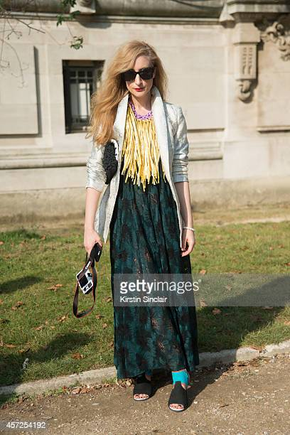 Fashion Designer Estelle Michaelides is wearing a Micky in the Van dress Maryann Talia Pau necklace Kenzo shoes and Karen Walker sunglasses on day 8...