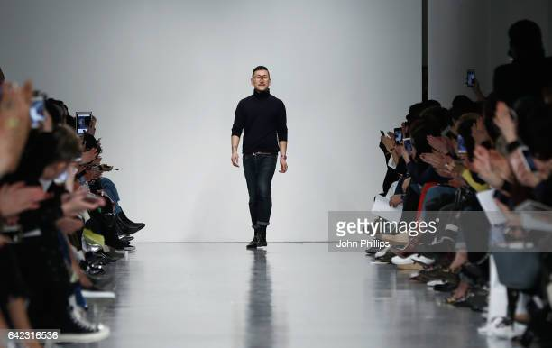 Fashion designer Eudon Choi on the runway after his show during the London Fashion Week February 2017 collections on February 17 2017 in London...