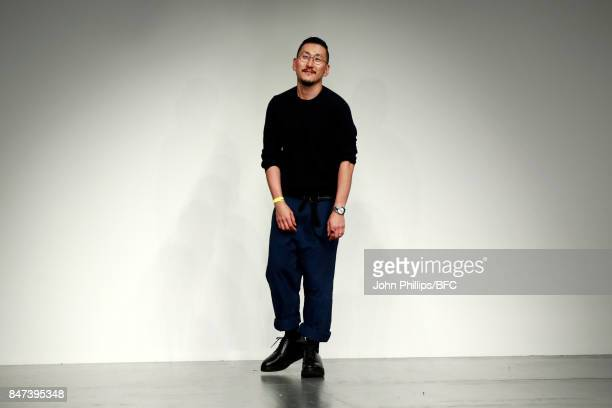 Fashion designer Eudon Choi walks the runway after his show during London Fashion Week September 2017 on September 15 2017 in London England