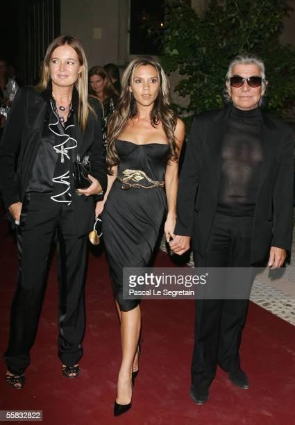 Fashion designer Eva Cavalli, Victoria Beckham and fashion designer Roberto Cavalli attend the Vogue Party during the Milan fashion week on September...