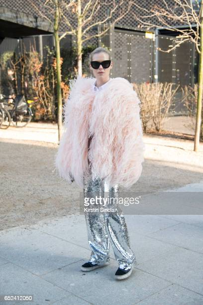 Fashion designer Federica Cavanati wears Celine sunglasses Vans trainers and 16Arlington trousers shirt and feathers on day 2 of London Womens...