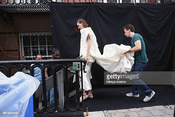 Fashion designer Fernando Garcia walks with a model backstage before the Monse fashion show during Spring 2016 MADE Fashion Week at Norwood Club on...