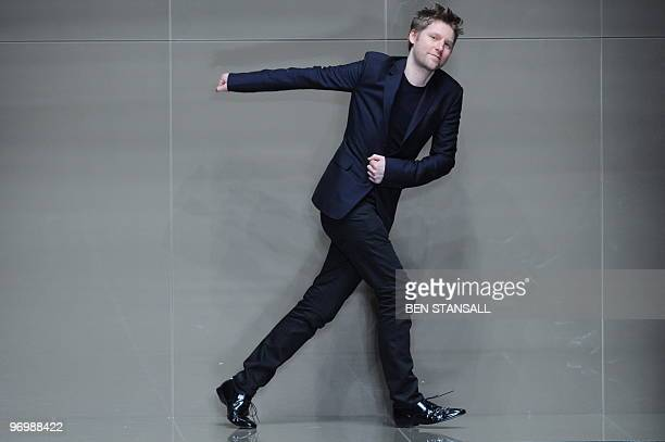 Fashion designer for Burberry Christopher Bailey acknowledges the audience following a fashion show for Burberry's Autumn/Winter 2010 collection on...