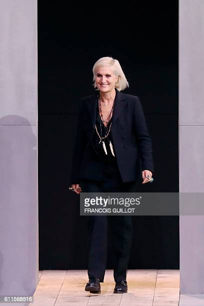 Fashion designer for Christian Dior Maria Grazia Chiuri acknowledges the audience at the end of the 2017 Spring/Summer readytowear collection fashion...