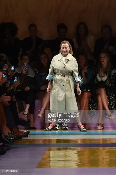 Fashion designer for Miu Miu, Miuccia Prada, acknowledges the audience at the end of the 2017 Spring/Summer ready-to-wear collection fashion show, on...