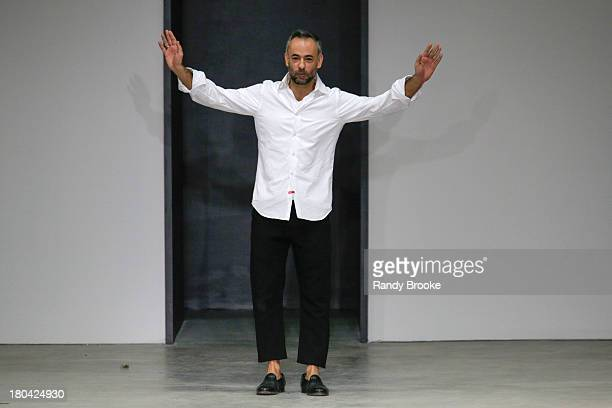 Fashion designer Francisco Costa greets the audience at the Calvin Klein Collection show during Spring 2014 MercedesBenz Fashion Week on September 12...