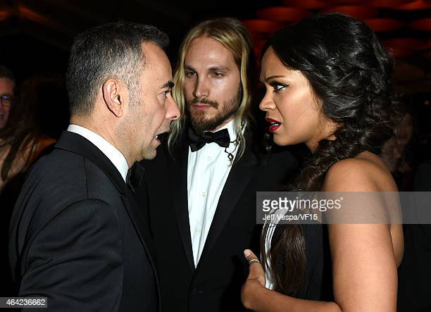Fashion designer Francisco Costa Marco Perego and Zoe Saldana attend the 2015 Vanity Fair Oscar Party hosted by Graydon Carter at the Wallis...