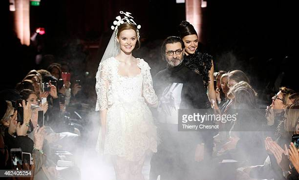Fashion designer Franck Sorbier acknowledges the applause of the audience at the end of the Frank Sorbier show as part of Paris Fashion Week Haute...